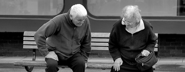 Two old people on a bench